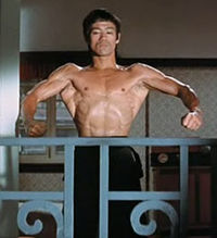 Lee flexing (1972), front