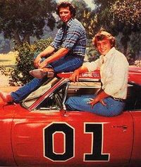 Bo and Luke Duke in their famous car, The General Lee
