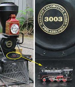 One of the smallest (Z scale, 1:220) placed on the buffer bar of one of the largest (Live steam, 1:8) model locomotives.