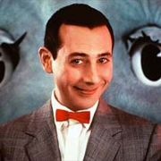 Paul Reubens as his most famous character, Pee-Wee Herman.