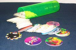 A collection of pogs and a typical pog case.