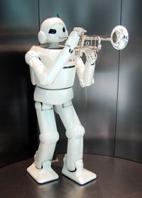 "A humanoid robot manufactured by Toyota ""playing"" a trumpet"