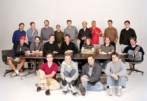 The Simpsons writing staff in season 13, including current show runner Al Jean (fourth from left in middle row) and previous show runners Mike Scully (first from left in back row), David Mirkin (sixth from left in back row), and Mike Reiss (fourth from left in back row).