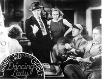 The boys with Ted Healy in the 1933 film, Dancing Lady. Joan Crawford looks on.