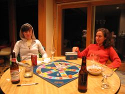 Two women playing Trivial Pursuit.