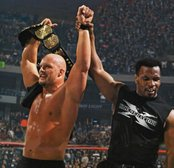 Steve Austin celebrates with Mike Tyson after winning the WWF title at WrestleMania XIV.